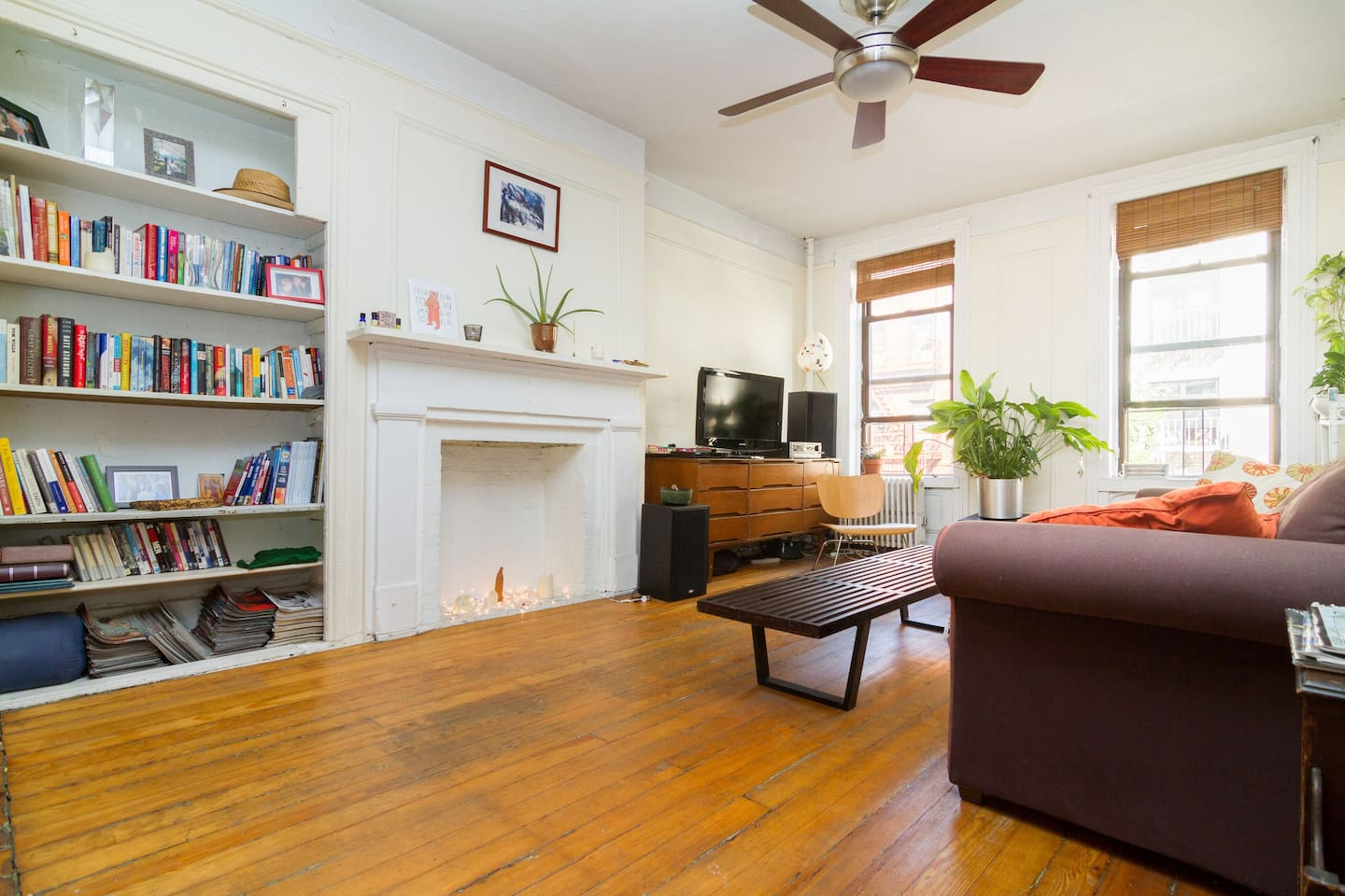 The living room is at the front of the apartment, facing Ave B.  Spacious, welcoming, warm