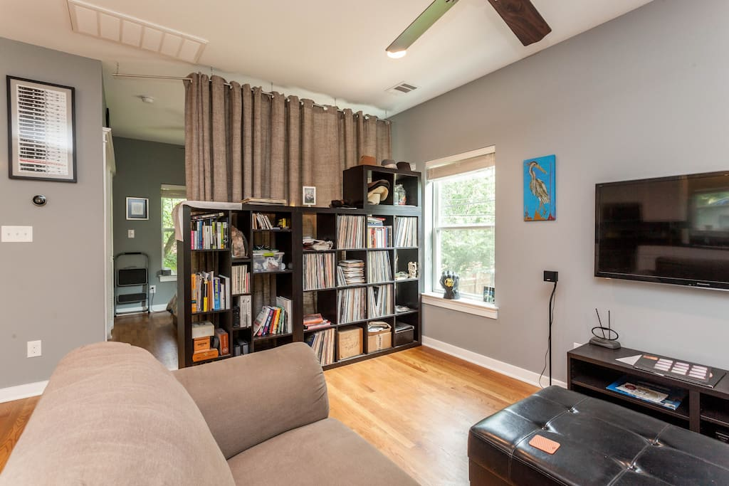 """Living area. Bedroom behind curtain. Includes 47"""" LCD TV with Netflix, WiFi, and stereo."""