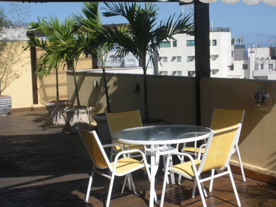 Roof Top Terrace with Table and Chairs