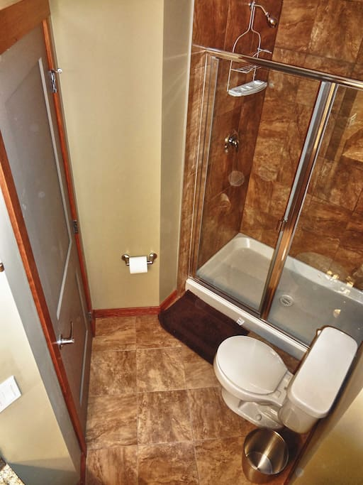 Walk-in show with upgraded luxury shower-head.