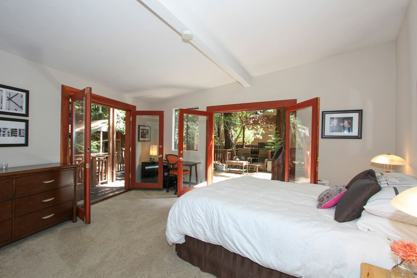 Master bedroom with french doors that access the large redwood deck
