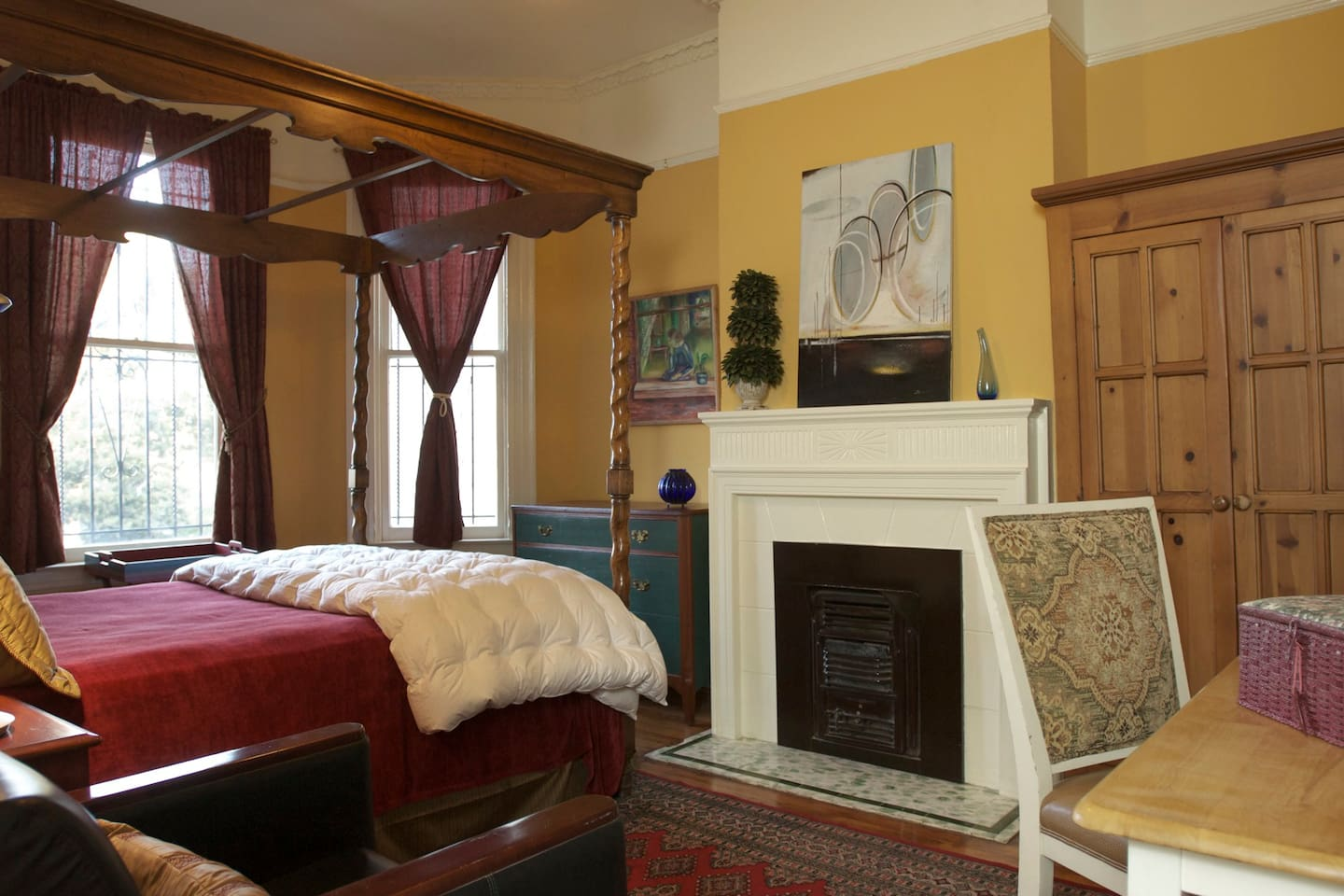 Front bedroom with queen canopy bed