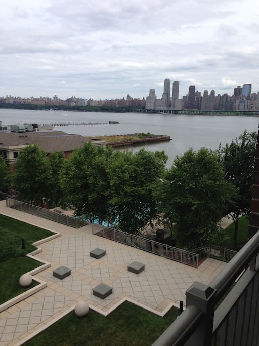 Balcony on lower floor with mid town NYC views overlooking the pool which you can also access if you choose.