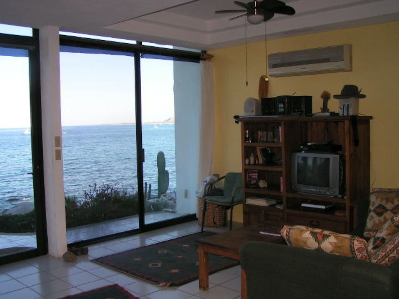 Living room with view of sea (all rooms have AC; and there is now  new flat panel display for watching DVDs)s.