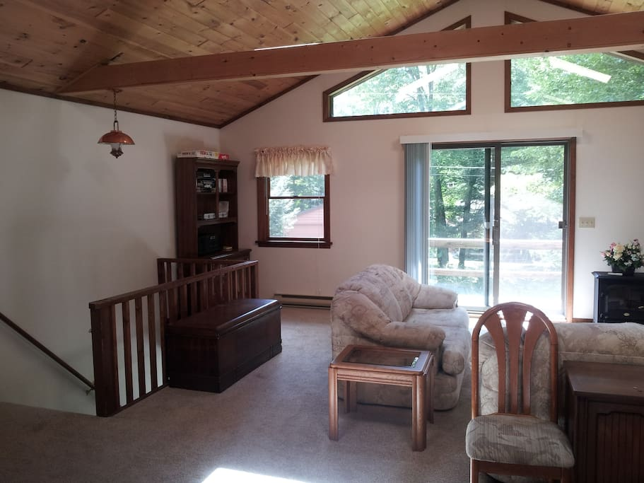 2nd floor living area with skylights and balcony.