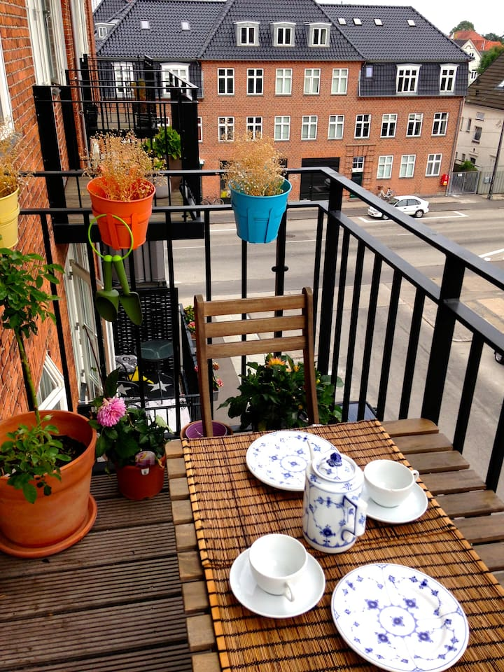 The balcony is a nice place to enjoy the breakfast in the summertime