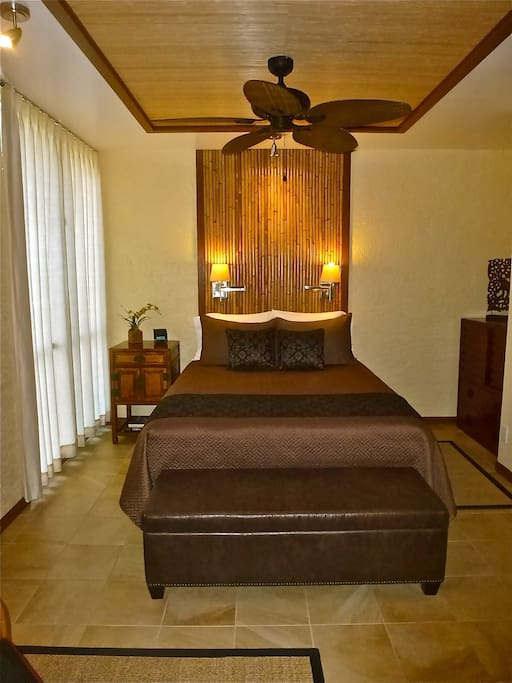Custom headboard in this large queen size bedroom - elegant and very comfortable