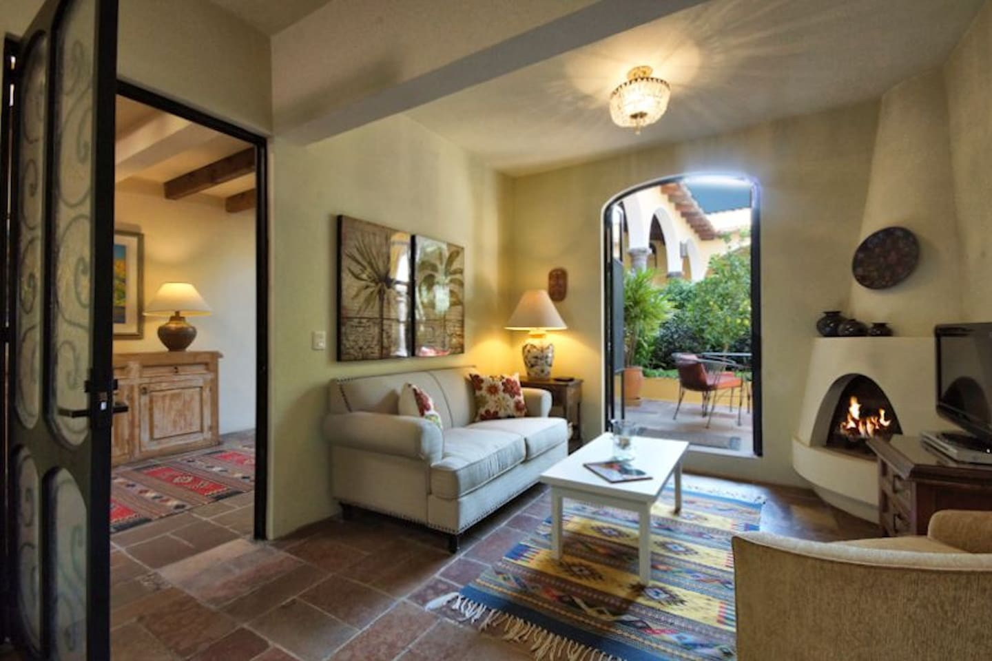 This view from the kitchen shows the outside foyer as well as the living room of this cozy casita.