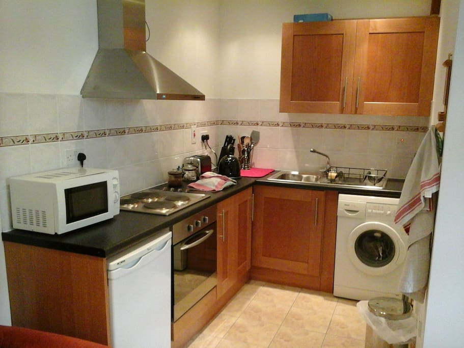 Modern kitchen with essential appliances necessary for short stay