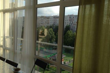 Большая квартира в видом на город - House
