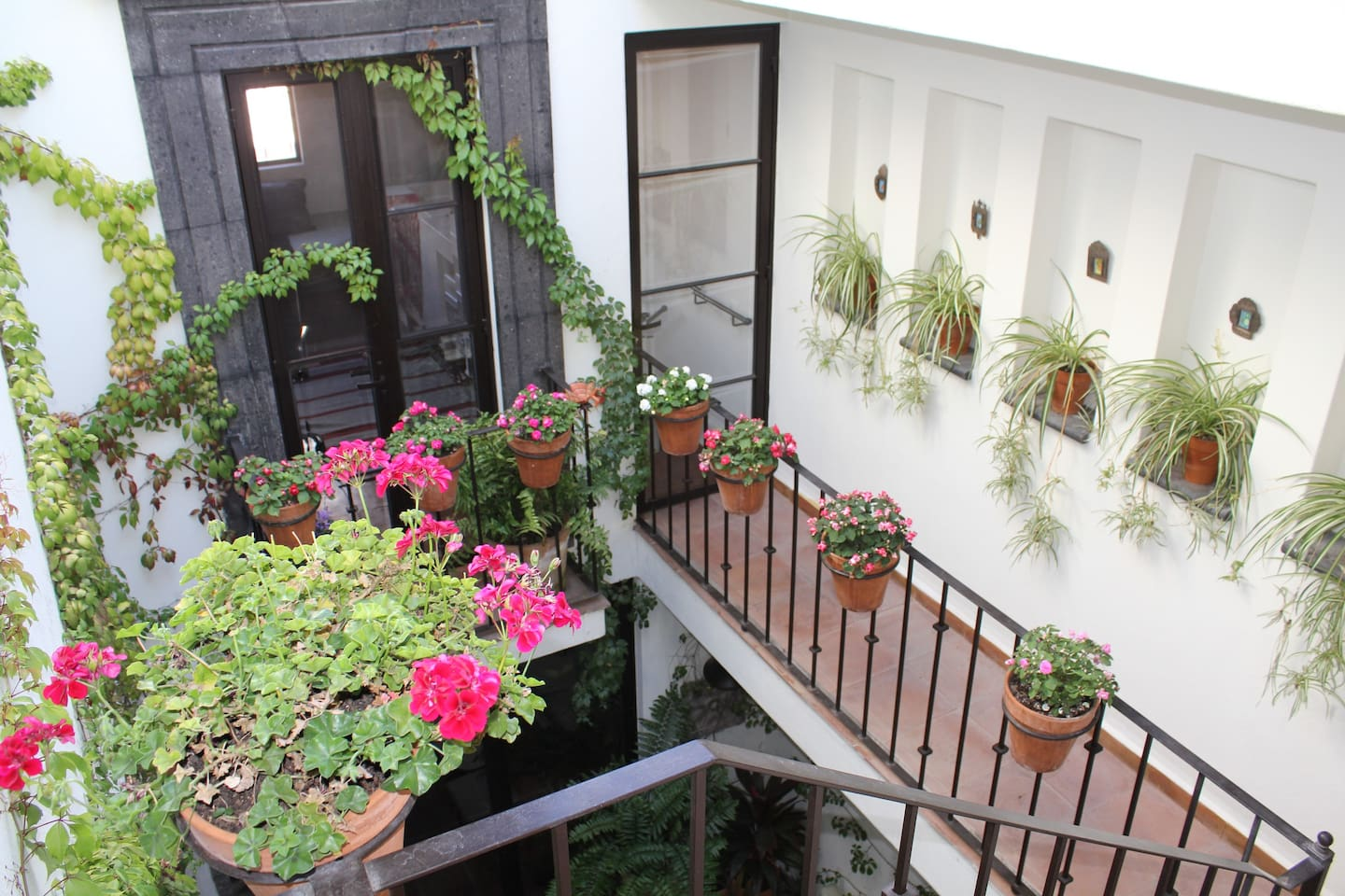 Townhouse in the Centro with open-air atrium, terraces, and clean, spare, beautiful design.