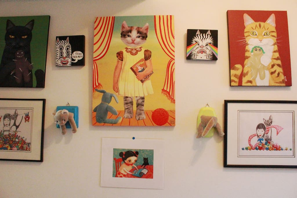 A wall of cat art to greet you upon arrival!
