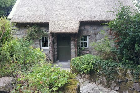 Beautifully restored Pre-Famine cottage. Listed on The Financial Times as a tranquil escape from the bustle of modern life. Rural setting surrounded by lacy stone walls, secluded gardens, and still on the outskirts of the cultural city of Galway.