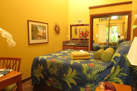 Hawaiian Sanctuary is a tropical permaculture farm & eco-rejuvenation center.  Enjoy the comfortable Gardenia Room in our main lodge which includes access to our spa, amenities, & some classes with weekday healthy smoothie breakfast.