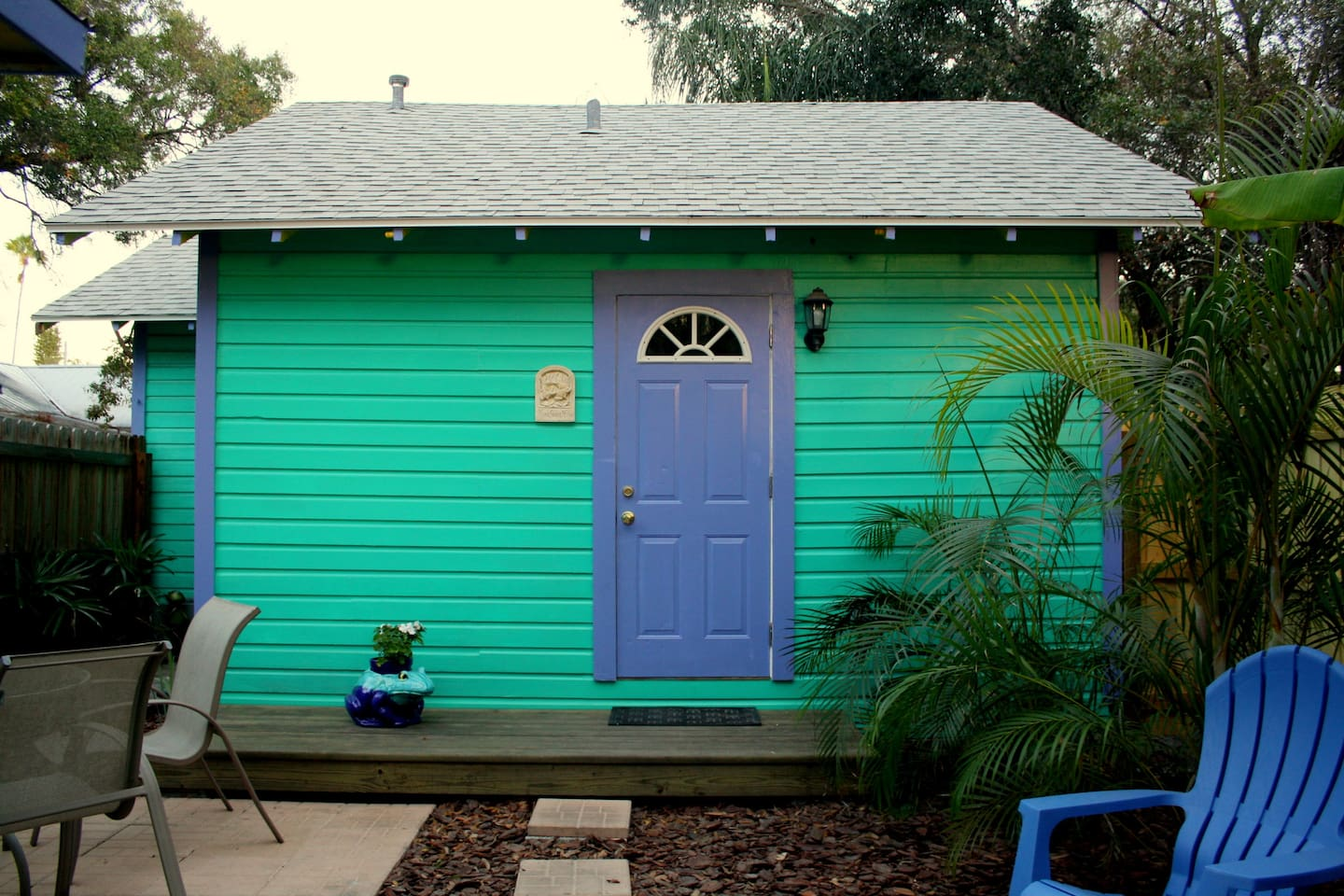 The historic 1925 Frog House has a tropical, completely fenced private back yard.