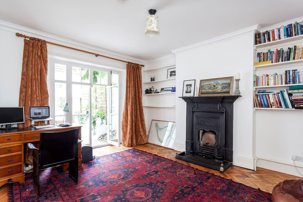 Large open living room with glass doors onto garden