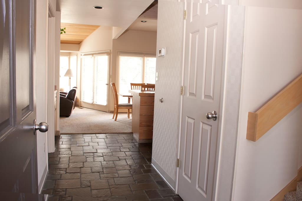 Stone entryway and vaulted ceilings.