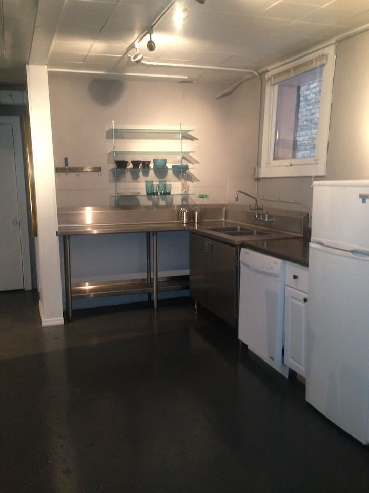 Stainless steel sink , glass shelves ,dishwasher and new refrigerator .