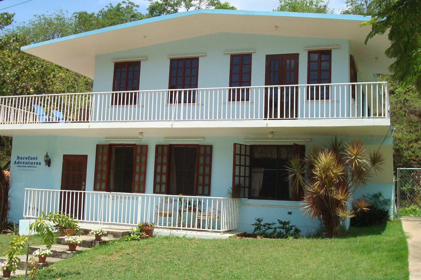 View of the Barefoot Guest House in a beautiful neighborhood close to the beach