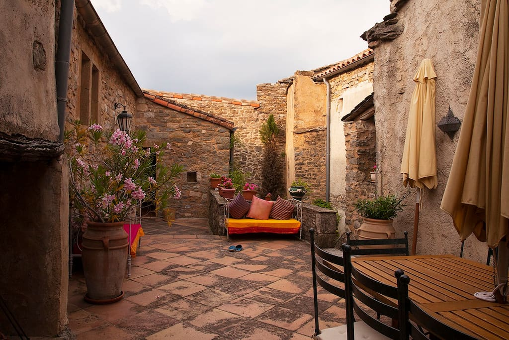 Private Courtyard and terrace. Table for 12. Fireplace to the left  for pleasure and Barbeque.