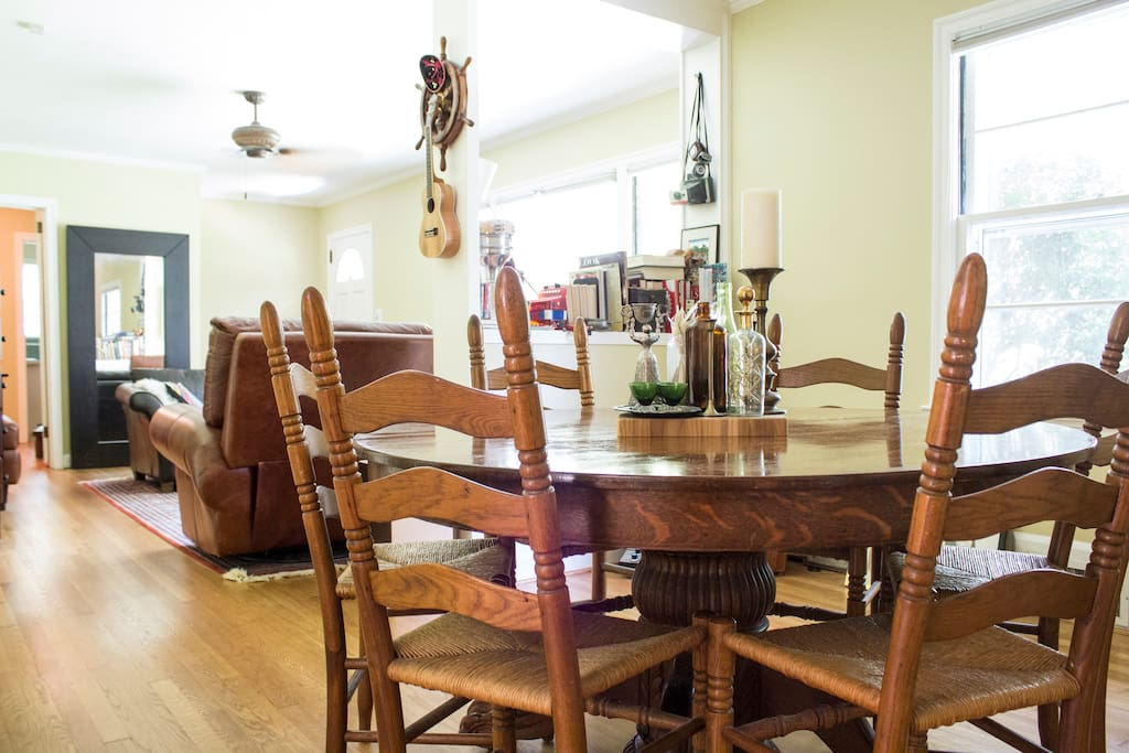 Common area and dining room flow together. Table seats six.