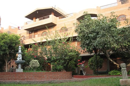 Wide and confortable room with private bathroom , hot water , tv and Wifi . Spacious garden ,