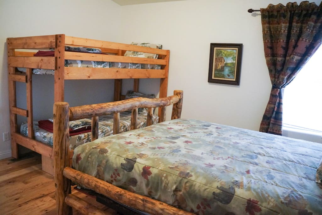 Bedroom with a bunk bed, This room has  entrance to the bathroom and 4 people may sleep comfortable