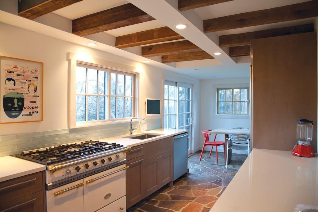 Gourmet kitchen with Sub-zero fridge, Bosch dishwasher, custom cabinetry, quartz counters, French stove