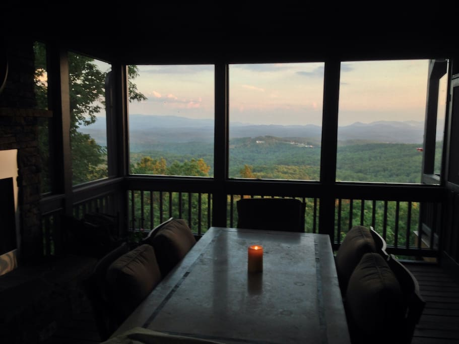 DINNER AND A SHOW is found here with outdoor dining for 6 on the screened porch with fireplace and stunning views