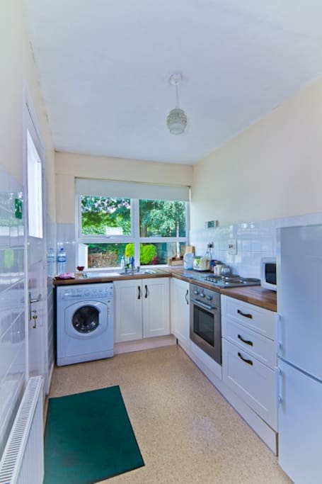 Kitchen will all cooking facilities. Washer dryer machine also available