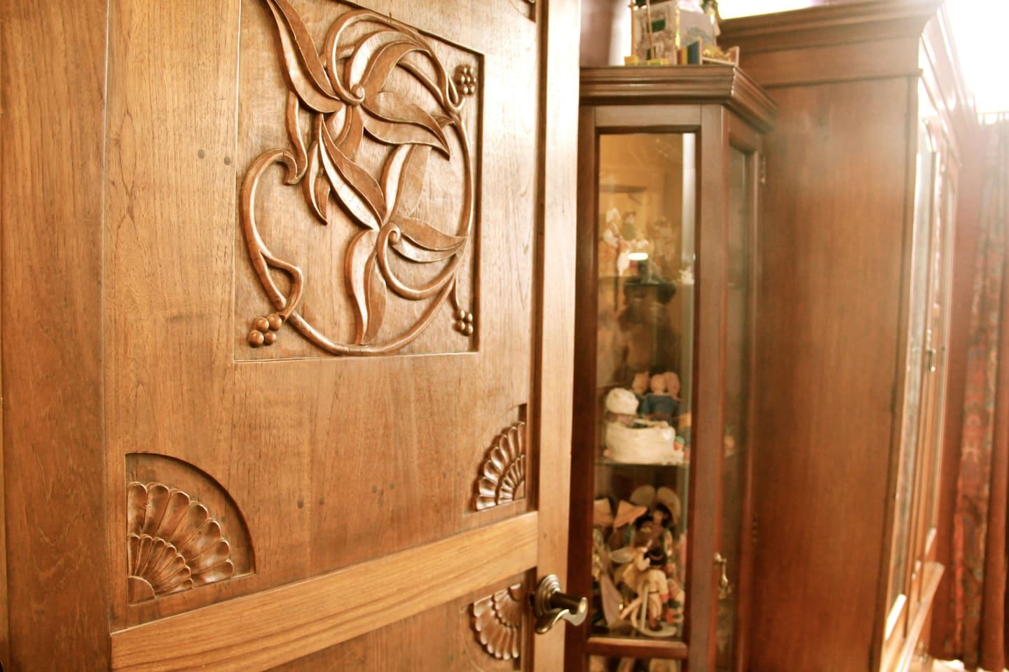 Carved wood door invites you into private bedroom
