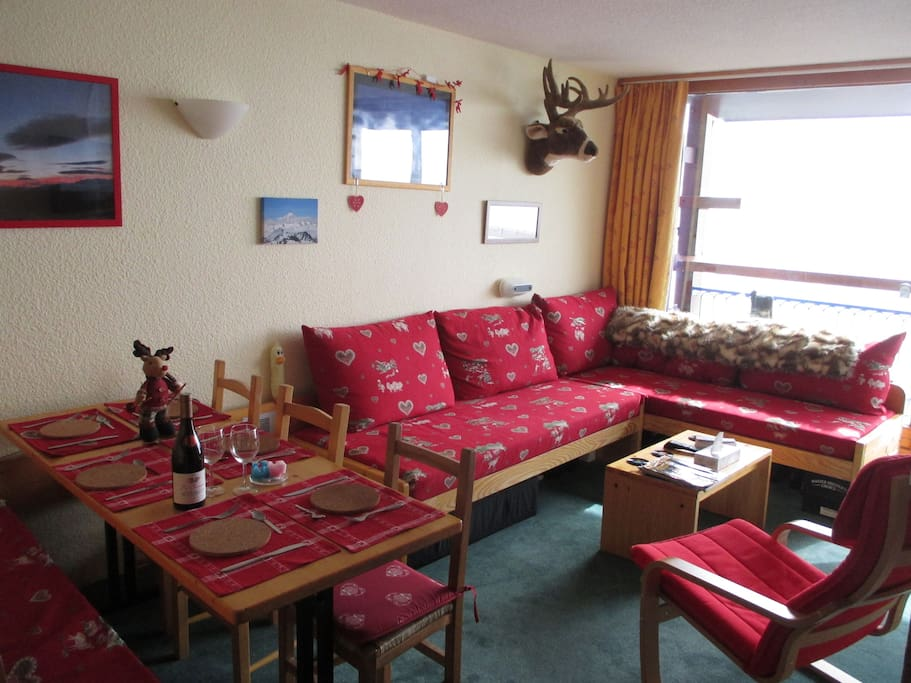 Living room/diner with new savoyarde patterned seat coverings.