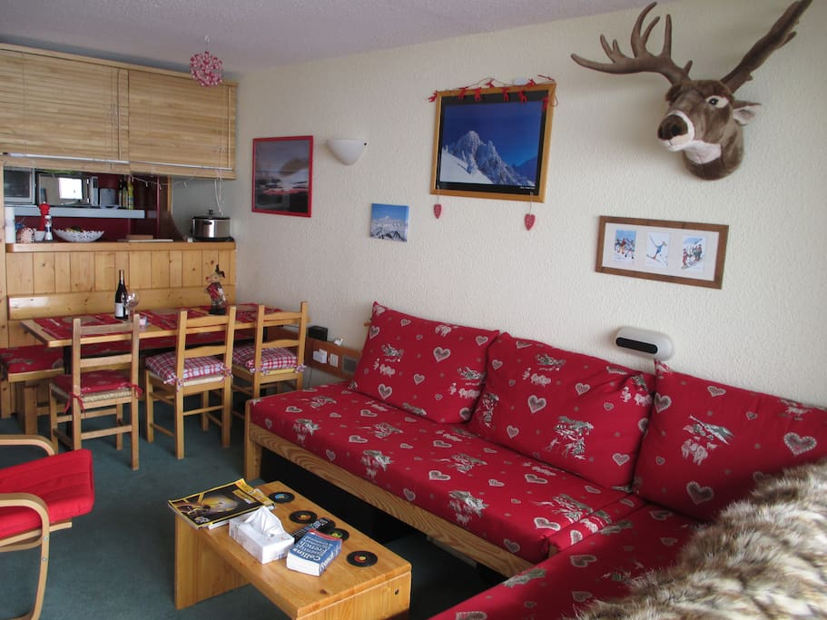 Living room with kitchen at the rear.