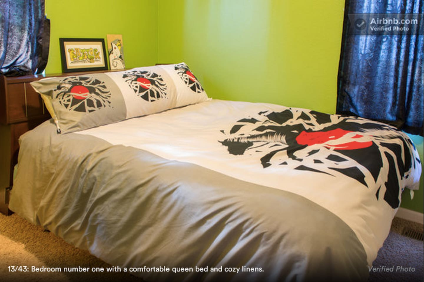 A very comfortable bed in room furnished with vintage design pieces.