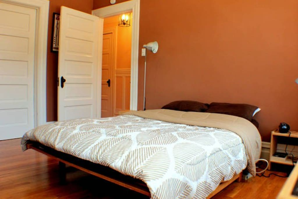 Master bedroom is in the front of the house and secluded from the living area in the back.