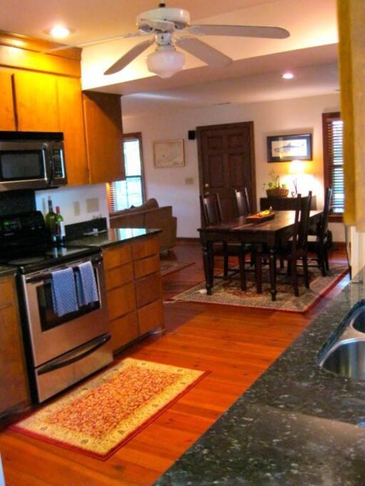 Granite countertops, heart pine floors, dining room table