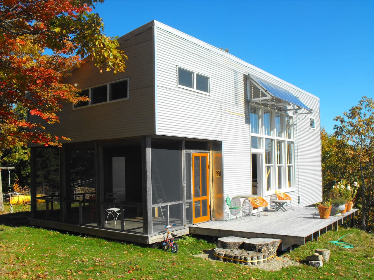 Facade, solar panels to power the camp