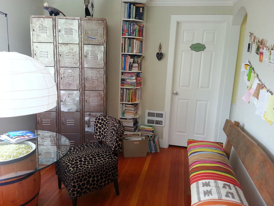 the living room is a cozy, quiet, warm space for reading, napping, socializing, or computing.