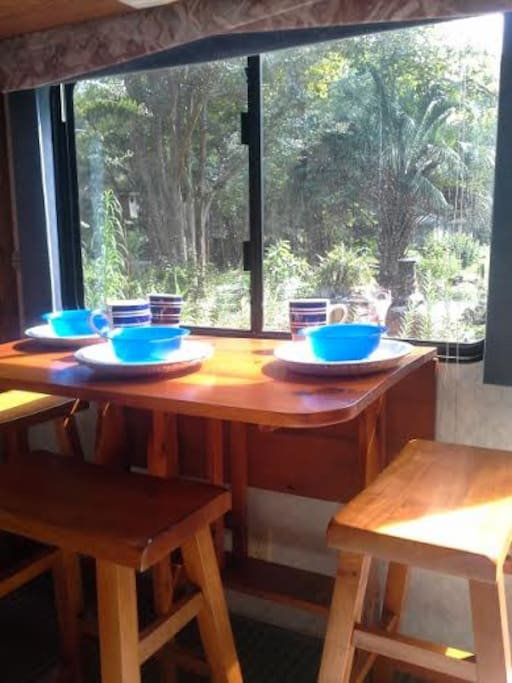 Custom wood dinette with a view of the garden