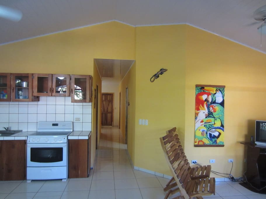 Hall leads to bedrooms, large full bath and laundry area.
