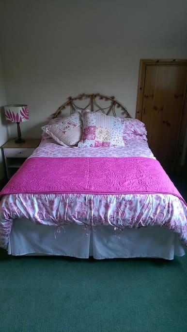 Very comfortable double bed in our quiet guest room