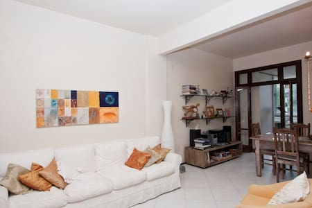 "We live in a very special place, in our beautiful city of Rio! So safe, clean, nice, residential, and genuine ""carioca"" neighborough! The bedroom that is waiting for you is a very big, sunny one (originally two bedrooms!),with 30 sq.2, large window!"