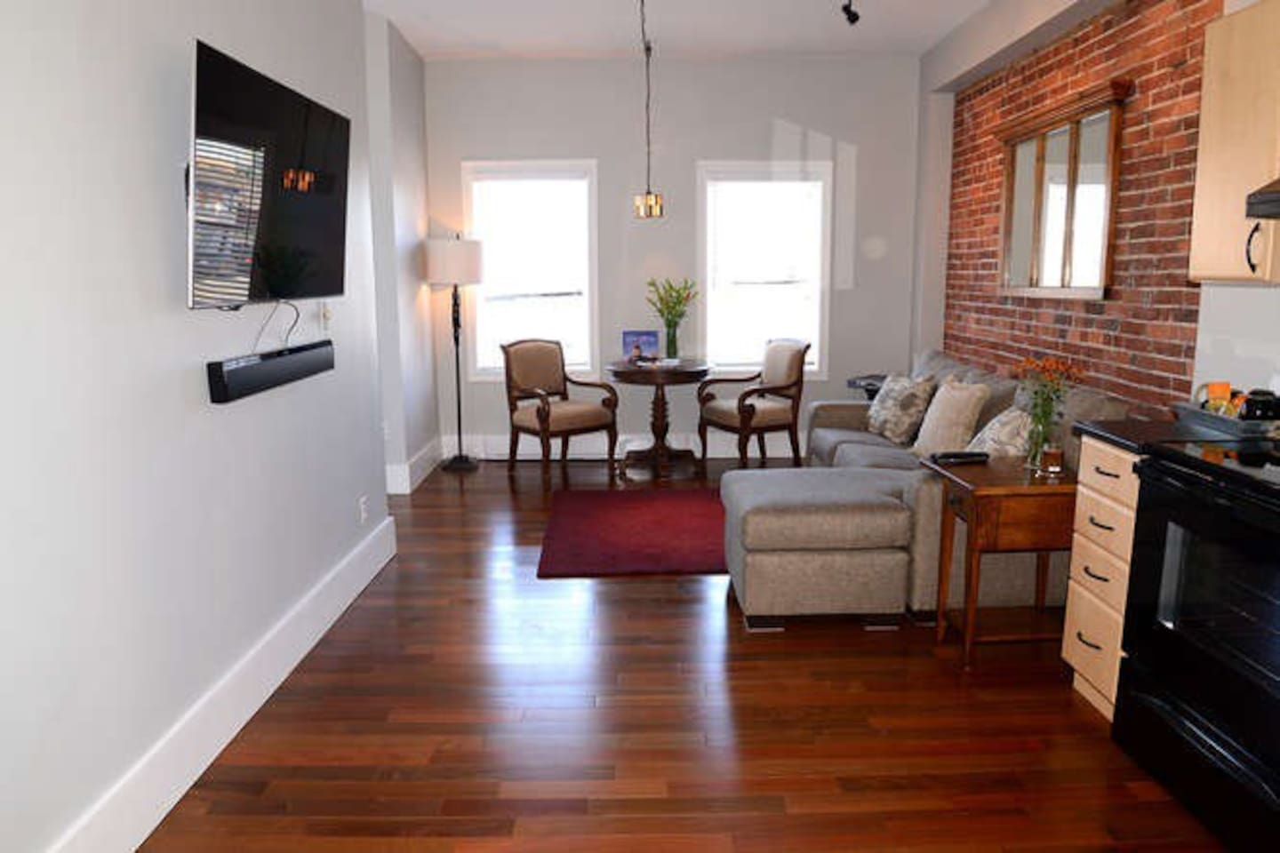 Great room with amazing natural light, brand new exotic hardwood floors and comfortable seating options.