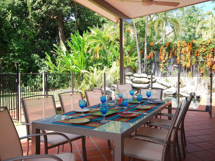 Covered outdoor dining overlooking the pool