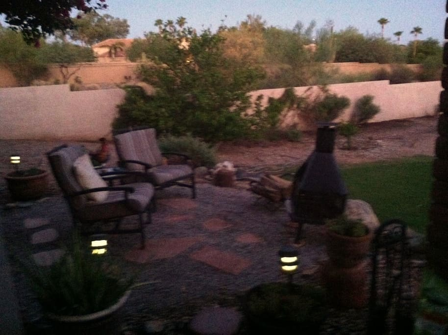 Enjoy a spectacular sunset overlooking our one acre desert landscape.  The  sitting area  is directly outside your room.