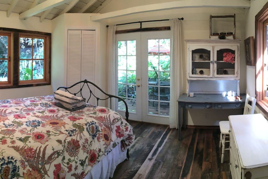 This spacious bedroom offers a full closet, dresser, desk with hutch and nightstand with 180 degree garden views out the windows and french doors.  Relax and make yourself at home!