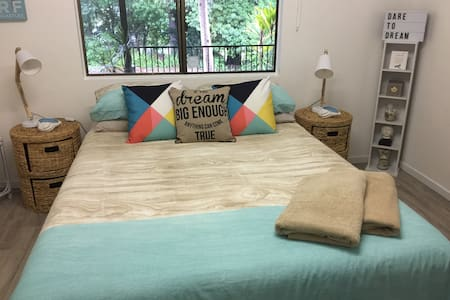 A QUEEN SIZE BED ON PEACEFUL ACRES