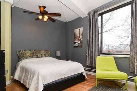 You will be staying in a wonderfully vibrant room with large windows and plenty of space. You will also have rooftop access and may use all appliances. There is a lively bar downstairs that plays music every night. Nightcap anyone?