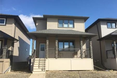 Modern 1 bdrm w/ Queen bed and bath in basement - Moose Jaw
