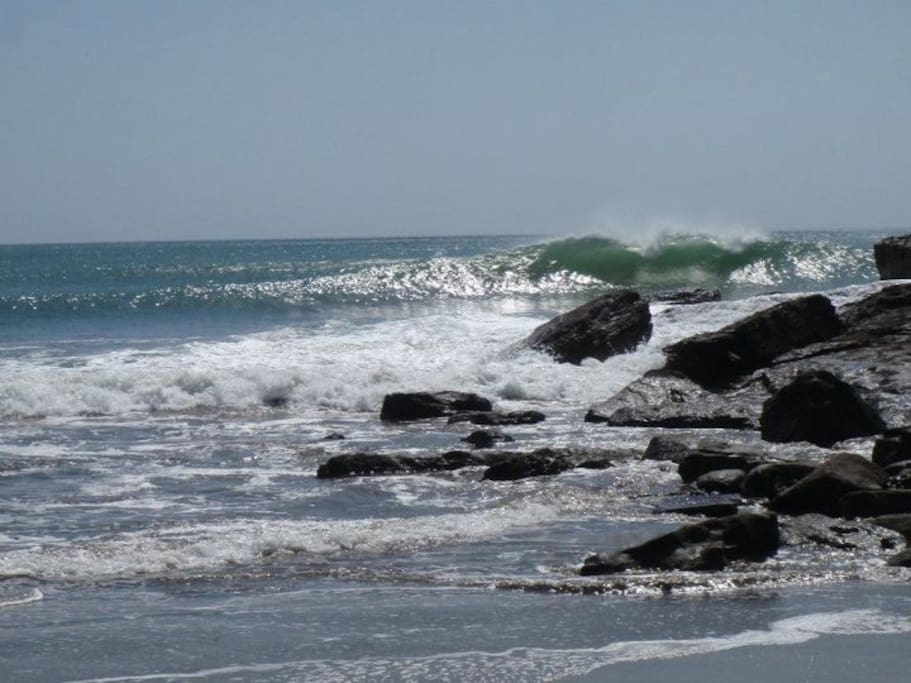 Here's what it really looks like.  There is sandy beachs on both sides of this rocky point